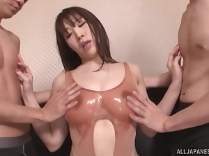 honcho  Rinne Toukae sucks up one side of her friend's cock in a threesome