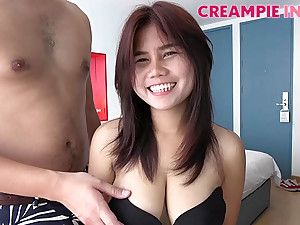 Naturally busty Asian babe is ready for her creampie